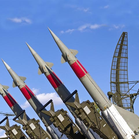 rockets of a surface-to-air missile system are aimed in the sky